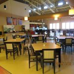 Communal seating area with multiple tables