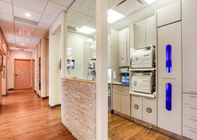 Glass divider between sterilization station and hallway