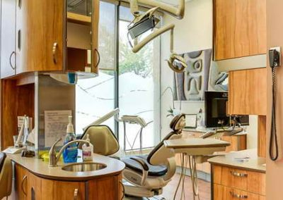 Custom wooden cabinets to divide patient areas in dental operatory