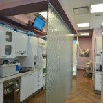 Damask glass wall divider between backroom of dental clinic and dental operatory