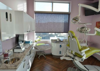 Violet walls and green dental operatory patient chair