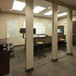 Glass walls dividing separate areas in workspace