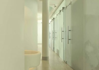 Natural lighting throughout dental clinic hallway with glass sliding doors