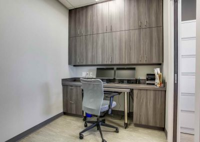 Custom built in office desk with wall cabinets