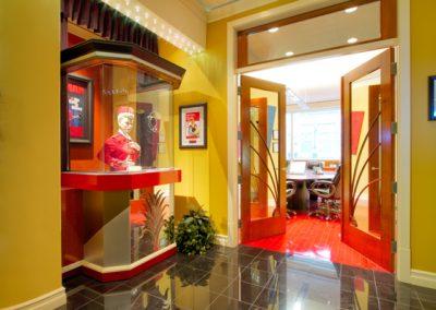 Cinema themed hallway leading into double doors of meeting room