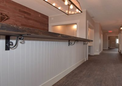 White paneling below wooden reception counter