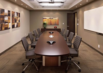 Large private boardroom with wooden boardroom table