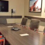 Meeting space with board room table and custom red leather chairs