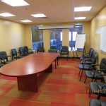 Conference room with large boardroom table and seating