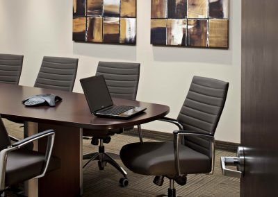 Boardroom meeting table with laptop