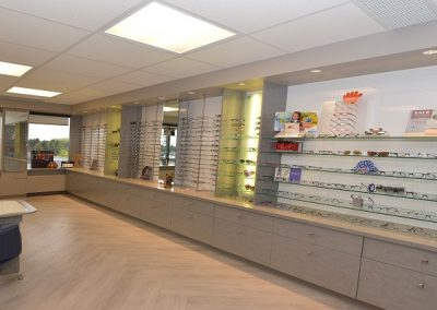 Showcases custom eyewear display cases using the natural light from the windows. Clean, modern, lots of product selection available.