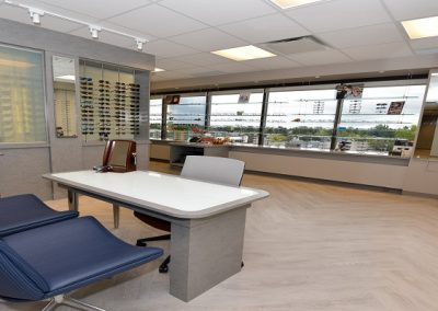 Open concept eyewear dispensary with display of eyeglasses