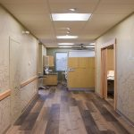 Hallway in dental clinic with sketched murals on the wall