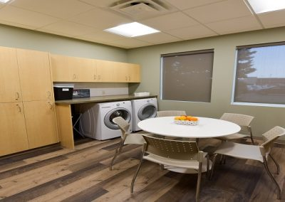 Staffroom with seating area and washing machines