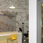 Open concept window showroom with communal hightop seating area