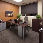 Private office space with brown feature wall