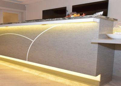 Custom front desk design with light accents