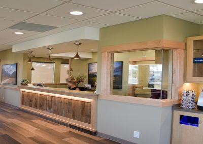 Wooden accents in waiting room area of dental clinic