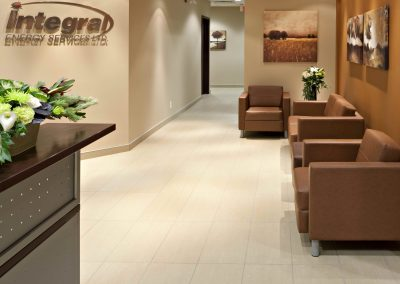 Office hallway leading to reception desk and waiting room