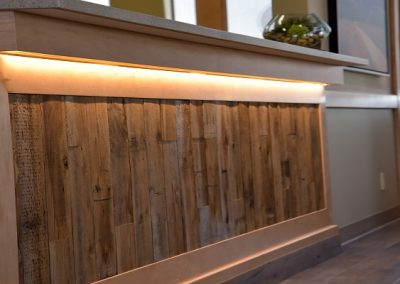 Reception desk with natural wooden elements and under counter lighting