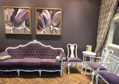 Luxurious violet and white themed waiting room with damask wallpaper