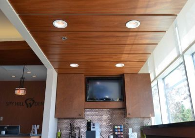 Wooden paneling above waiting room coffee bar