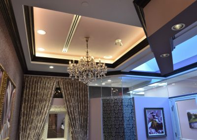 Multi level ceiling design with luxurious chandelier in perio waiting room