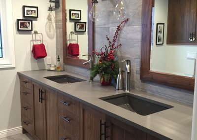 Renovated bathroom with custom cabinets and double sinks