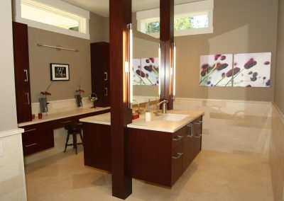 Large bathroom remodel with matching sinks separated by a shared mirror