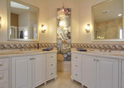 Bathroom remodel with beach theme and his and her matching vanities