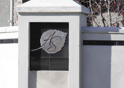 Aspen Summit Cement pillar with metal leaf design