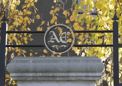 Aspen Estates steal fence design above cement pillar