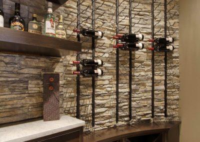 Custom built wine rack next to bar