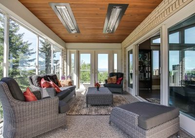 Large sunroom with wooden ceiling and ceiling heaters