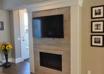 Living room renovation with tv placed directly above fireplace