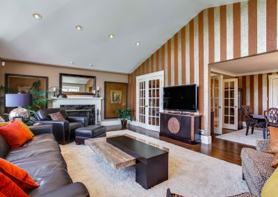 Striped wallpaper feature wall in family tv room