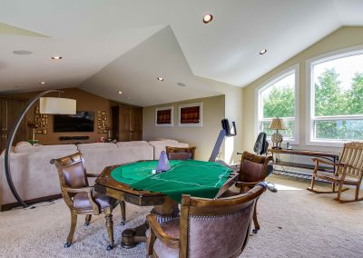 Large living room with seating area and poker table