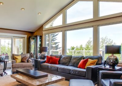 Living room with large triangular arched window letting in natural light