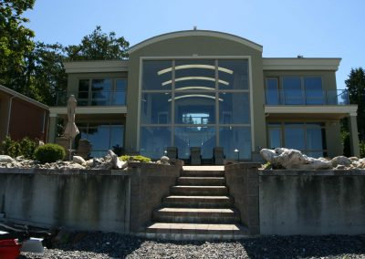 Steps leading up from beach to large oceanfront property