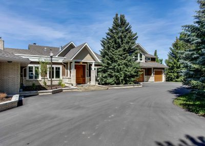 Large driveway leading towards front entrance of home