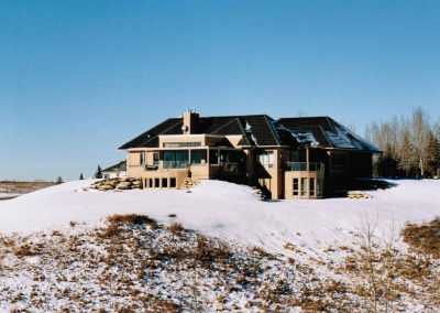 Newly renovated house on acreage covered in snow