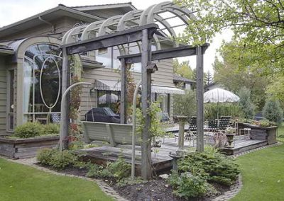 Arched backyard pergola on deck