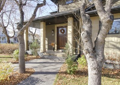 Front walkway leading up to corner lot