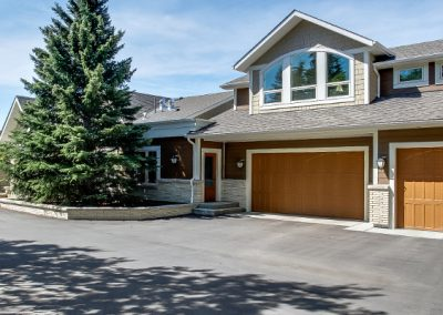 Driveway leading up to double car garage