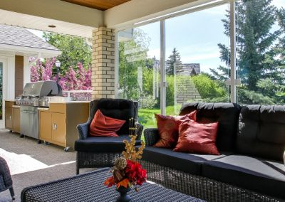 Outdoor patio with glass windows surrounding the patio