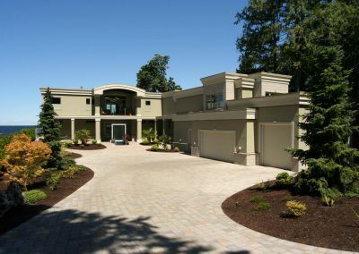 Large driveway leading up to oceanfront home