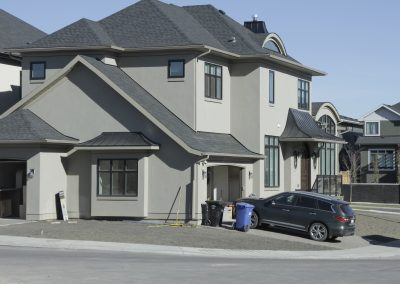 New custom home in Aspen Ridge Estates on the corner lot with two driveways