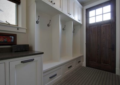 newly renovated mudroom attached to side door of house