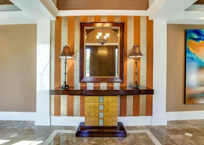 Entryway of home with large table and mirror