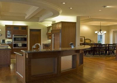 Expansive kitchen with long arching island and wooden features